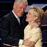 Former President Clinton embraces wife Hillary before speaking at Democratic National Convention